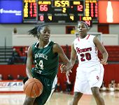 NEW YORK-NOV 3: Farmingdale Rams forward Siohban Purvis (14) dribbles past St. John's Red Storm guar