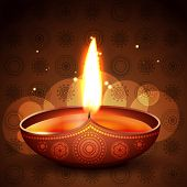 beautiful diya placed on artistic vector background