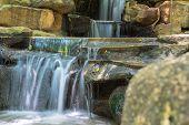 Artificial waterfall in botanical garden