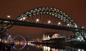 stock photo of tyne  - An image of the Newcastle Quayside beautifully lit up at night with the Tyne Bridge being the main focal point - JPG