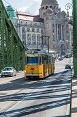 The Green Freedom Bridge, With Yellow Tram, In Budapest,the Capital Of Hungary