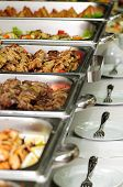 picture of chafing  - banquet table with many chafing dish heaters - JPG