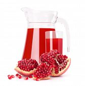 Pomegranate fruit juice in glass pitcher isolated on white background cutout