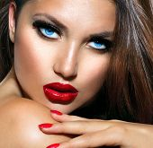 Sexy Beauty Girl with Red Lips and Nails. Provocative Make up. Luxury Woman with Blue Eyes. Fashion Brunette Portrait. Gorgeous Woman Face. Long Hair