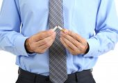 Business man breaks down the cigarette, isolated on white