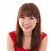 Close up portrait headshot of Asian woman smiling wearing red dress isolated on white background. As