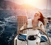 Woman behind the wheel yacht, enjoying sea nature and mountains landscape, active sailor girl, female driving luxury water transport, summertime concept
