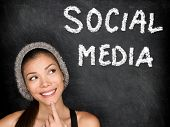 Social media concept with university student looking thinking at SOCIAL MEDIA text on blackboard. Fe