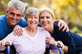 foto of mother law  - portrait of mid age couple and senior mother outdoors - JPG