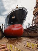 picture of shipyard  - A large tanker ship is being renovated in shipyard Gdansk Poland - JPG