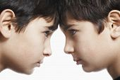 pic of preteen  - Closeup of preadolescent siblings with head to head isolated over white background - JPG