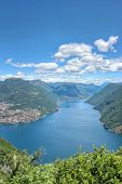 stock photo of salvatore  - Mountain panorama scenic landscape view in southern Alps at lake Lugano Mount San Salvatore in Como district in Italian and Swiss border - JPG