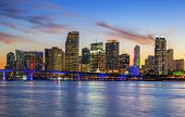 foto of florida-orange  - CIty of Miami Florida summer sunset panorama with colorful illuminated business and residential buildings and bridge on Biscayne Bay - JPG