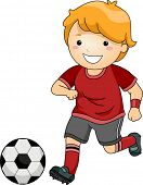 Illustration of a Little Boy in Soccer Gear About to Kick a Soccer Ball