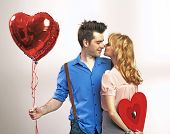 valentines couple with heart balloons