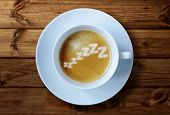 Coffee cup with zzzzzzz in the froth concept for exhaustion, overworked and feeling tired