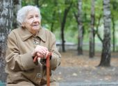 foto of elderly woman  - Beautiful portrait of an elder woman outdoors - JPG
