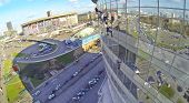 MOSCOW, RUSSIA - OCT 30, 2013: (view from unmanned quadrocopter) Industrial abseiler wash windows of