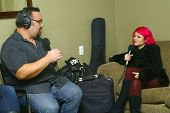 SOLANA BEACH, CA - JAN. 15: Allison Iraheta is interviewed by David Dawson prior to her performance