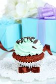 Tasty cupcake with gifts close up