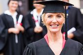 stock photo of professor  - pretty middle aged university professor at students graduation ceremony - JPG