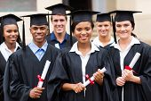 image of graduation gown  - portrait of multiracial graduates holding diploma - JPG