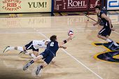 IRVINE, CA - JANUARY 17: Brigham Young's Carson Heninger dives for the dig in a volleyball match wit