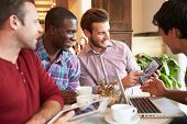 Group Of Male Friends Meeting In Caf�?�?�?�© Restaurant