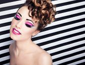 Face close up of beautiful young woman with professional party make up false eyelashes