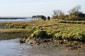 Estuary with ruined building