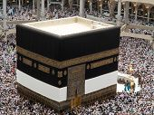 picture of mekah  - Kaaba the Holy mosque in Mecca with Muslim people pilgrims of Hajj praying in crowd  - JPG