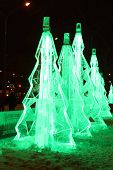 Perm, Russia - Jan 11, 2014: Many Illuminated Ice Christmas Trees In Ice Town At Evening. Constructi