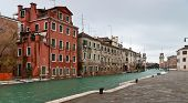 stock photo of arsenal  - Venice Arsenal entrance with towers and canal view in winter time