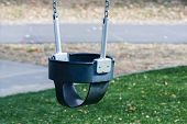 image of swingset  - Close up of a childs swings on empty playground - JPG