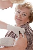 picture of flu shot  - senior female getting a swine flu injection - JPG