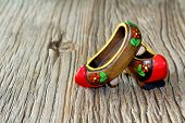 Traditional Turkish A Pair Of Clog With Atractive Style And Colorful On A Wooden Table