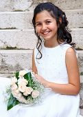 image of communion  - Smiling young girl in white dress for First Communion - JPG