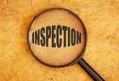 foto of inspection  - Magnifying glass focusing on the word inspection - JPG