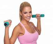 Beautiful Young Female Exercising With Dumbells