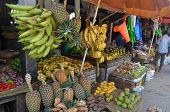 STONE TOWN, ZANZIBAR - DECEMBER 12: Sellers offer fruit and vegetables in the city market on 12 Dece