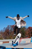 Skateboarder Jumps To Perform Trick At New Skatepark