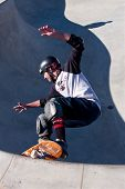 Skateboarder Skates In Big Bowl