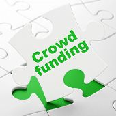 Business concept: Crowd Funding on puzzle background