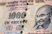 stock photo of gandhi  - A one thousand rupee banknote from India with the focus on the face of Mahatma Gandhi - JPG