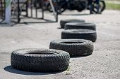 foto of heatwave  - a number of old tires lies on the road under the bright summer sun - JPG