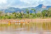 RURRENABAQUE, BOLIVIA, MAY 11, 2014 - Local people travel in traditional wooden boats on Beni river
