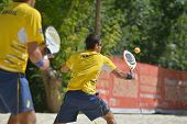 MOSCOW, RUSSIA - JULY 19, 2014: Man double of Brazil in the match against Spain during ITF Beach Tennis World Team Championship. Brazil won in two sets