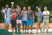 MOSCOW, RUSSIA - JULY 20, 2014: Team Russia celebrates the 3rd place in ITF Beach Tennis World Team