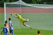 MOSCOW, RUSSIA - JULY 21, 2014: Goalkeeper Stefan Cupic saves the goal in the match OFK, Serbia - Ma