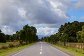 Scenic highway in South America - Carretera Austral. Farmland fenced low fence